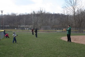 Giving his all in a throw to Coach Chris.